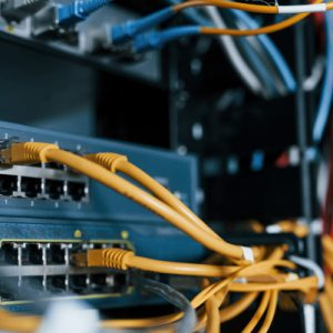 Close up view of internet equipment and cables in the server room.